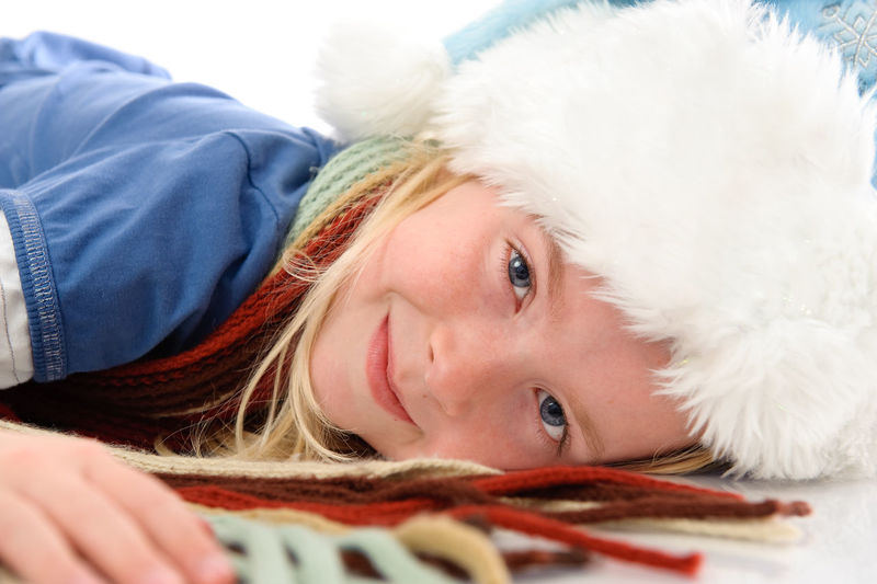 Close-up portrait of cute girl with hat