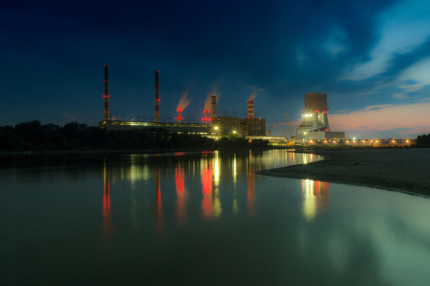 Power Stations Architecture Built Structure Capital Cities  City City Life Cityscape Cloud - Sky Development Engineering Illuminated Modern Night No People Outdoors Reflection River Sky Tall Tall - High Tourism Travel Destinations Urban Skyline Water Waterfront