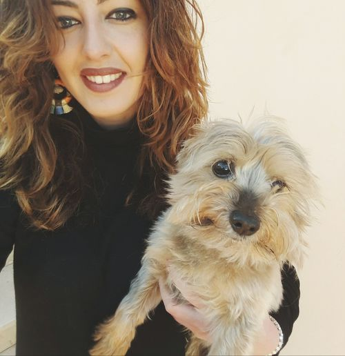 Pets Dog Happiness Smiling Only Women Adult Portrait Looking At Camera Adults Only One Woman Only Cheerful One Person People Cute Love Embracing One Young Woman Only Domestic Animals Young Adult Friendship