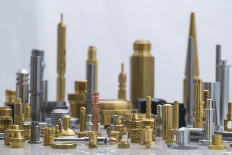 Close-Up Of City Made With Machine Parts Arranged On Table
