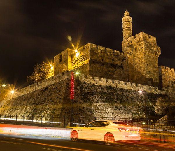 Cars moving on illuminated city at night