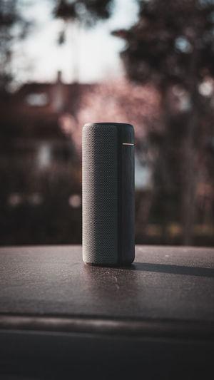 Speaker on wooden table