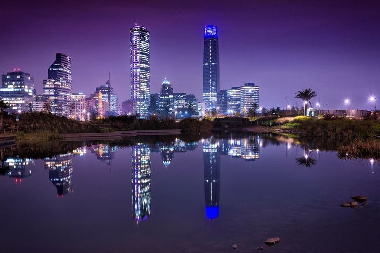 Reflection of illuminated buildings in river