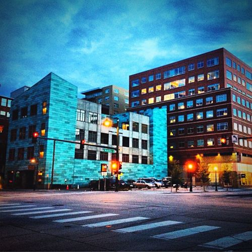 Something artistic about Denver builds. Illuminated Built Structure City Dusk Outdoors Denver,CO Vacant City Building Exterior Blue City Street Sky Buildings City Buildings Blue Architecture
