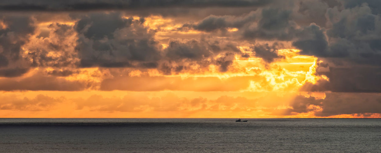 After Storm Storm Boat Cloud - Sky Clouds Dramatic Sky Horizon Horizon Over Water Orange Color Sea Sky Sun Sunrise Sunset Tranquil Scene Tranquility