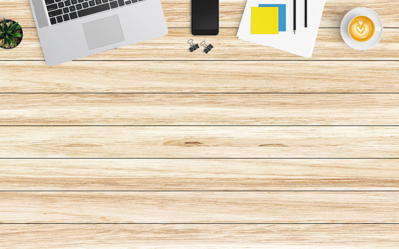 High angle view of laptop on wooden table