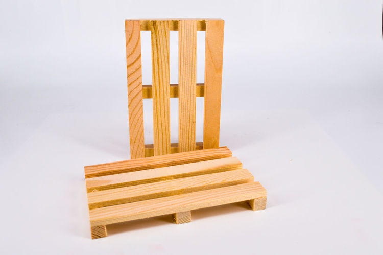 Wooden pallet on the white background. Base Business Construction Delivery Fabrication Industrial Industry Panel Production Battens Export Fabric Hardwood Lath Ligneous Manufacture Manufactured Metarial Object Pallet Plank Platform Stock Storage Stuff
