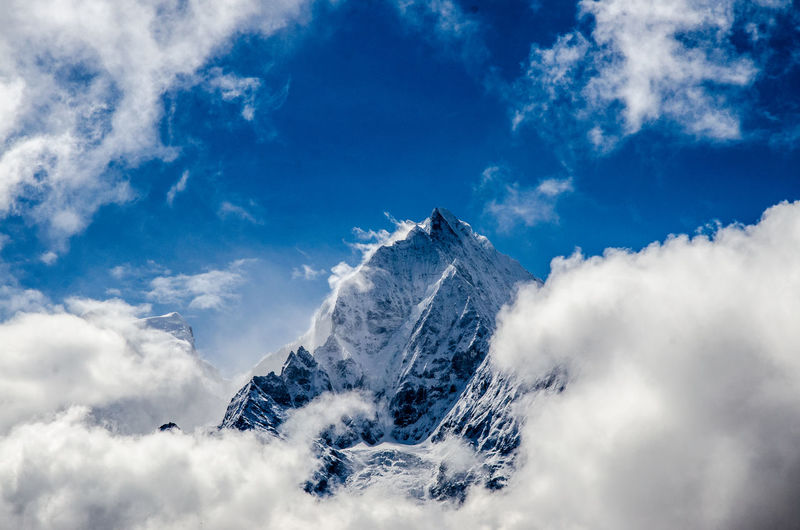 Clouds At Snow Covered Mountain Peak