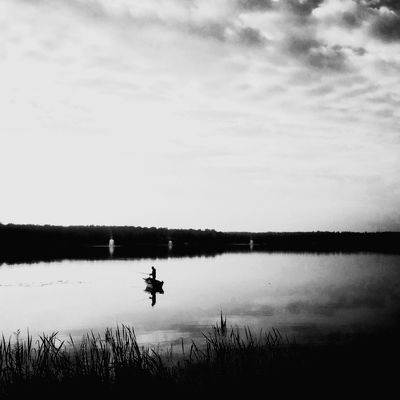 Lake Outdoors Non-urban Scene Beauty In Nature Reflection Nature Lifestyles Sky Bw_photooftheday Artystycznapodroz Lubiepolske Tychy Awesome Bwn_life Bnw_collection Mobilephotography Snapseed łódka Fisherman Fishing Fishermen Boat Shootermag