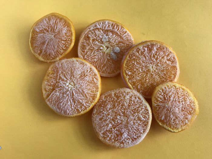 High angle view of  frozen sliced oranges on table