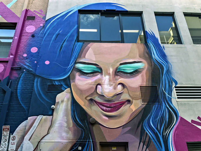 Street Art. Graffiti Adult Close-up Emotion Excitement Front View Happiness Headshot Leisure Activity Lifestyles Looking At Camera Mid Adult Mouth Open One Person Portrait Real People Reflection Smiling Streetart Teeth Women Young Adult