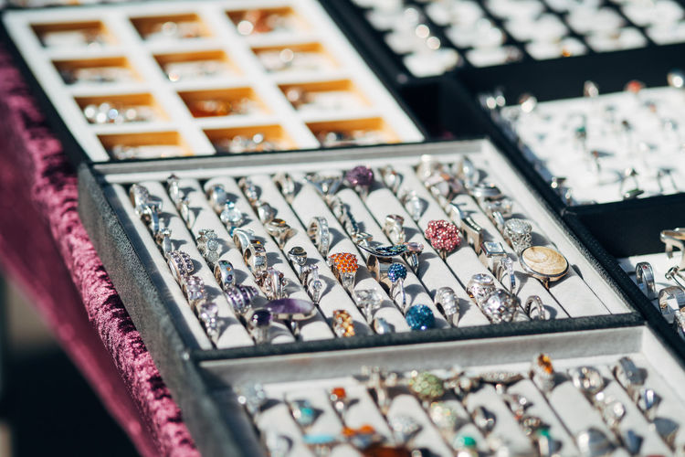Abundance Arrangement Box Choice Close-up Collection Fleamarket For Sale Gemstone  High Angle View Indoors  Jewelry Large Group Of Objects Luxury Multi Colored No People Retail  Retail Display Selective Focus Still Life Store Tray Variation