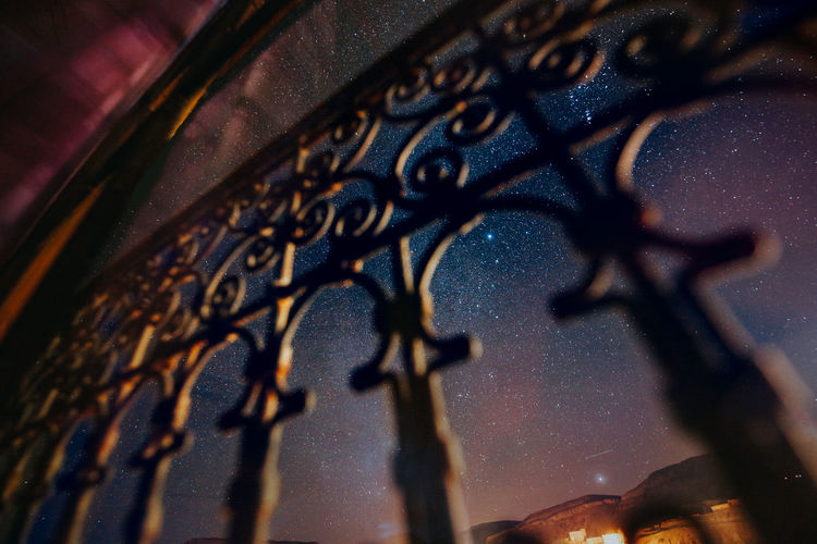 Low angle view of sky seen through gate