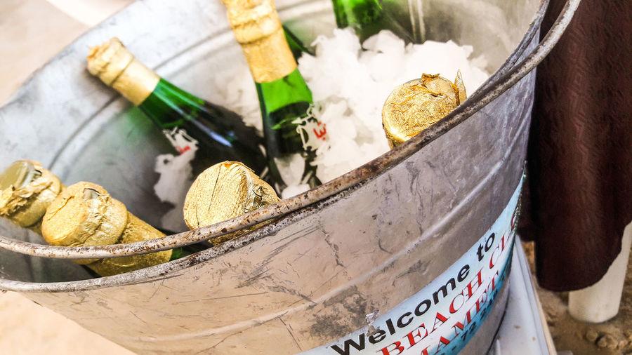 Close-up of beer bottles in ice bucket