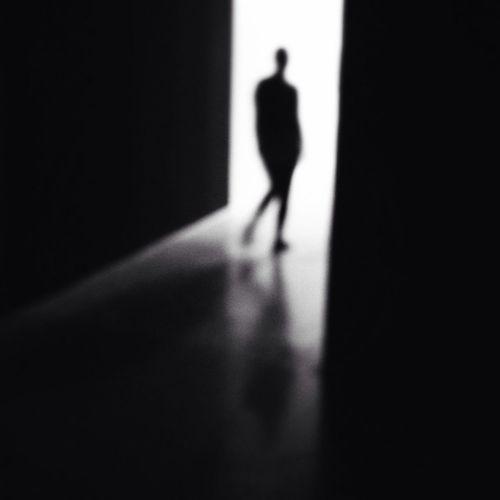 Strangers In Transit Darkness And Light Silhouette Light And Shadow Shootermag WeAreJuxt.com TheMinimals (less Edit Juxt Photography) Streetphoto_bw NEM Black&white Blackandwhite