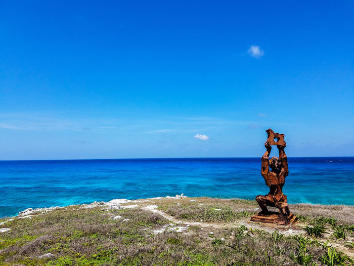 Horizon Over Water Water Nature Blue Sky Beauty In Nature Scenics Tranquility Day Horizon Outdoors No People May 2017 Spring Springtime Mexico Isla Mujeres Mexico Trapical Climate Waves Ocean Blue Water Rust Metal Grass Sculpture The Week On EyeEm