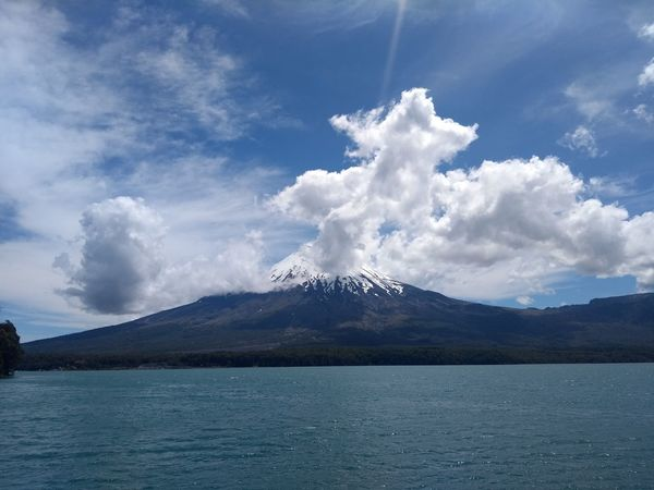 Volcán Osorno. #EyeEmSelects Chile Region De Los Lagos Petrohué Mountain Cloud - Sky Lake Landscape Mountain Range Sky Scenics Water No People Tree Snowcapped Mountain Outdoors Beauty In Nature Day Nature Blue