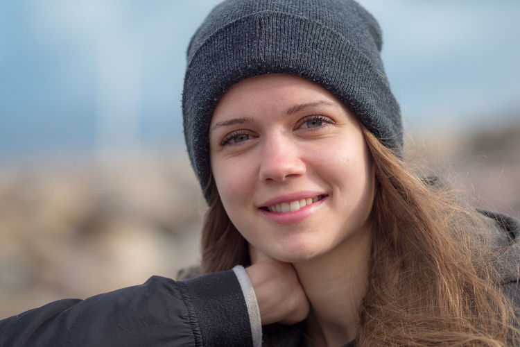 Portrait of smiling young woman wearing knit hat
