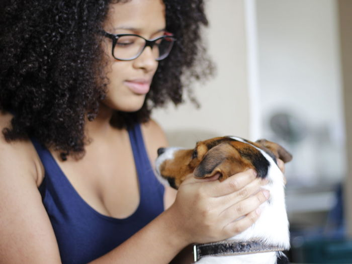 Animal Themes Curly Hair Dog Domestic Animals Eyeglasses  Focus On Foreground Friendship Indoors  People Pets Real People Young Adult Young Women Break The Mold EyeEmNewHere The Portraitist - 2017 EyeEm Awards Live For The Story
