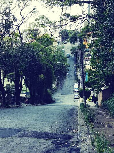 Uphill Downhill Sloping Road Urban Street Asphalt Pavement Slope Hilly Area City Cables And Wires Gray Sao Paulo - Brazil