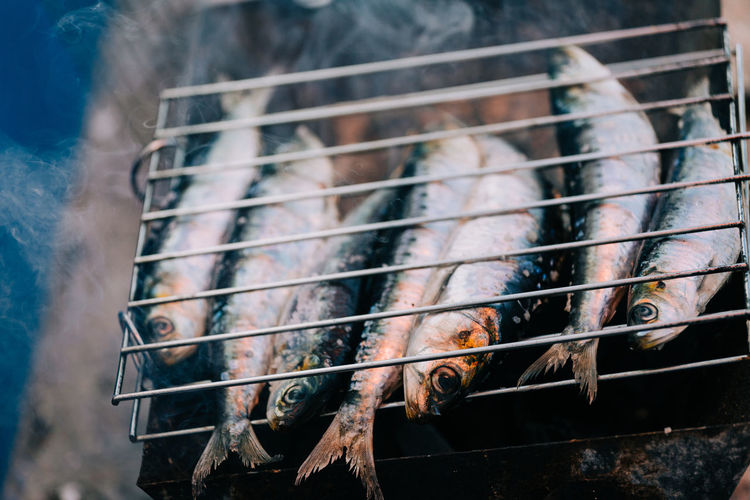 Close-Up Of Fish Grilling On Barbecue