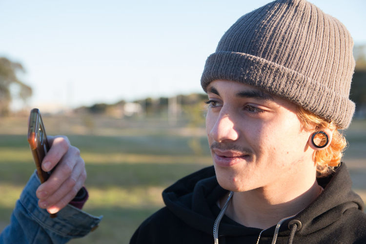 Portrait of young man wearing hat outdoors