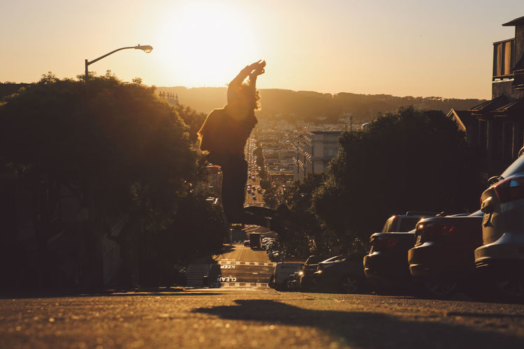 California City Lombard Street San Francisco Architecture Building Exterior Built Structure City Curly Hair Day Full Length Girl Jumping One Person Outdoors People Real People Silhouette Sky Street Sunset Tree Paint The Town Yellow California Dreamin Summer Road Tripping