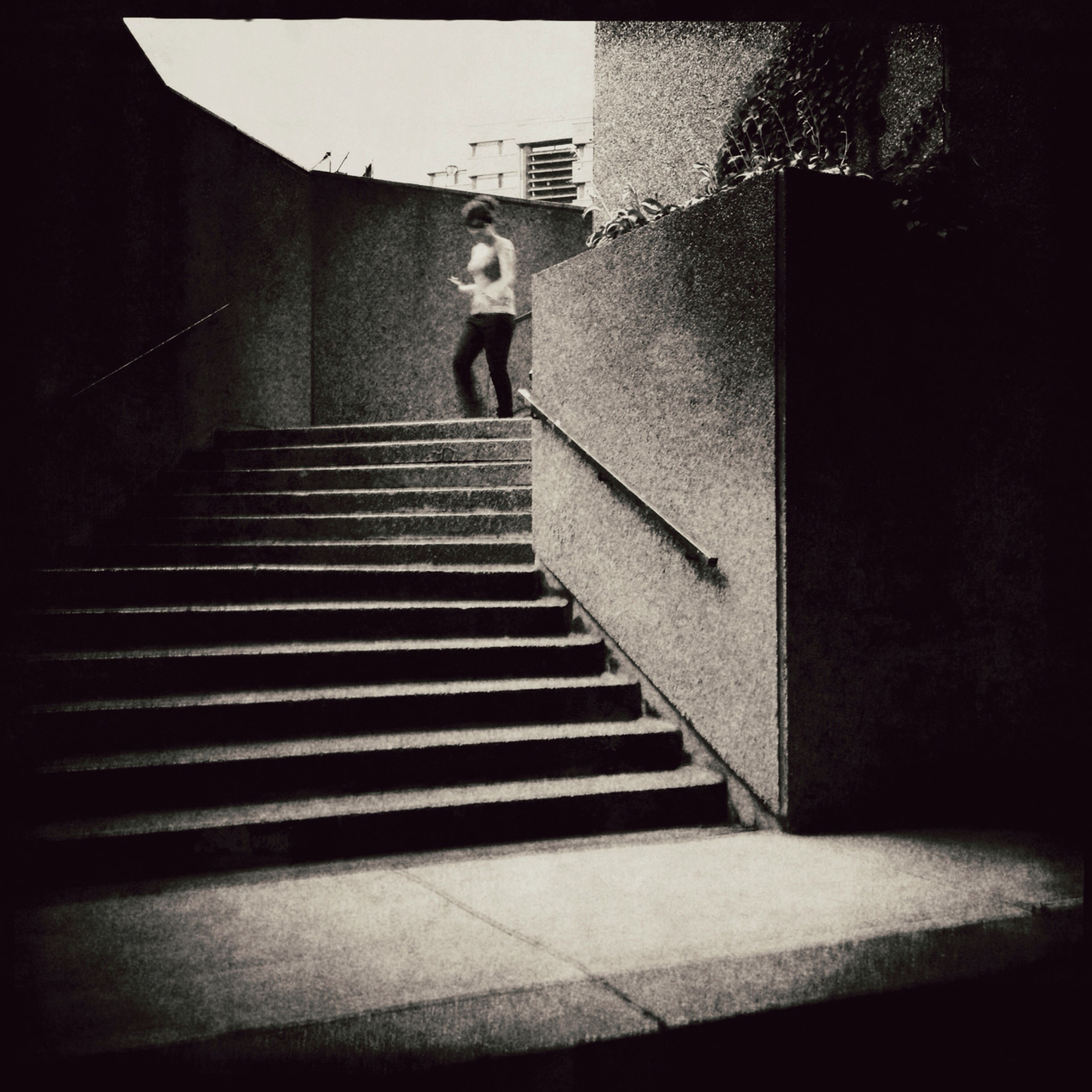 steps, steps and staircases, architecture, built structure, staircase, full length, the way forward, walking, building exterior, lifestyles, stairs, wall - building feature, rear view, leisure activity, standing, men, railing, person