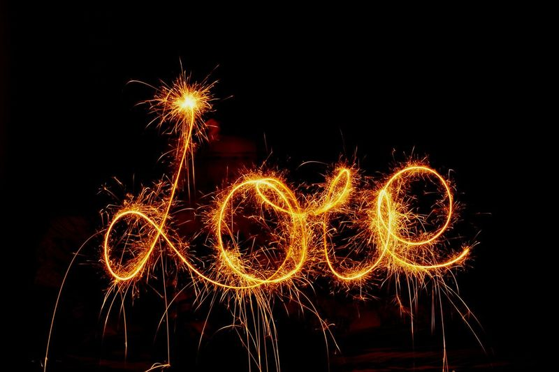 Love text made with firework display against black background