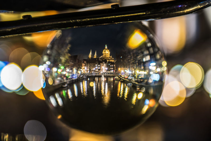 Church of Saint Nicolas The church of Saint Nicolas as seen through a crystal ball on the back of a bicycle in Amsterdam's red light district. Amsterdam Amsterdamcity Architecture Ball Bicycle Canal Central Church Colorful Crystal Ball December Diminishing Perspective Holland Long Exposure Netherlands Night No People Perspective Red Light District Saint Nicolas Sinterklaas Tourism View The City Light Paint The Town Yellow