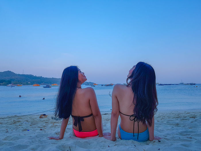 EyeEmNewHere Sky See The Light Sexygirl Sexywomen Nature Travel Girl Light And Shadow Picture Thailandtravel Blue Sky Sky And Clouds Blue Friendship Water Sea Togetherness Beach Sand Summer Bonding Women Beach Holiday Sandcastle Ankle Deep In Water Sand Pail And Shovel Bikini Bikini Top Beach Towel
