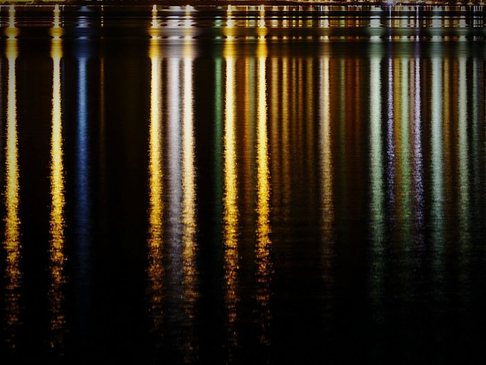Reflection Of Lights In Lake At Night