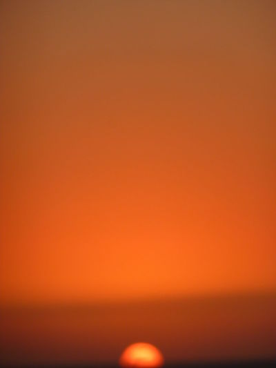 Full frame shot of illuminated orange sky