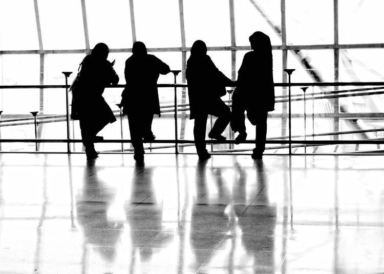 Women wearing hijab standing at airport