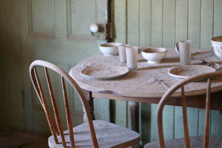 Close-Up Of A Table In An Abandoned House