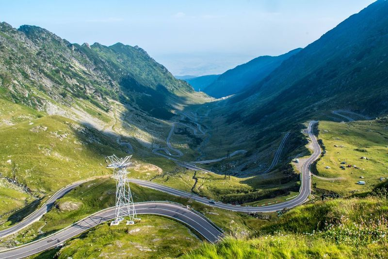 Road Mountain Transportation High Angle View Winding Road Landscape Nature Scenics Outdoors Beauty In Nature Curve No People Day Tranquility Sky Aerial View Mountain Range Mountain Road Grass