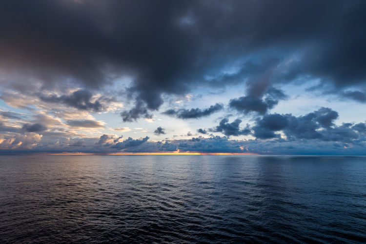 Storm is approaching Water Sky Tranquility Sea Dramatic Sky Horizon Storm Sunset Nature Overcast Seascape Storm Cloud Sunrise