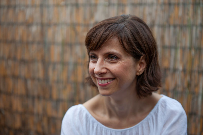 Woman Adult Beautiful Woman Brick Brown Hair Casual Clothing Emotion Focus On Foreground Front View Hair Hairstyle Happiness Headshot Looking At Camera One Person Portrait Smiling Teeth Toothy Smile Woman Portrait Women