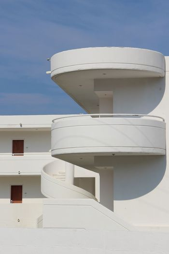 Low angle view of white building against sky