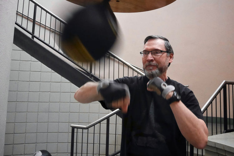 Man Practicing Boxing Against Steps
