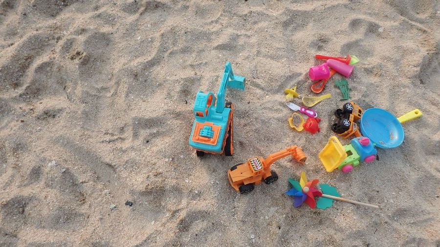 Toys on the beach. Kids Sand Beach Land Multi Colored High Angle View Toy Nature Vacations Outdoors