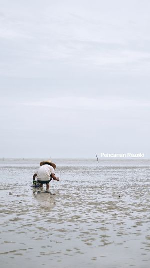 MORIB 1. EyeEm Selects Sea Seafood Fishing Industry Fish Fishing Nature Buoy Horizon Over Water Outdoors Fisherman Tranquility Occupation People Water One Person Day Beauty In Nature Full Length Sky Beach Real People Modern Rear View Adult