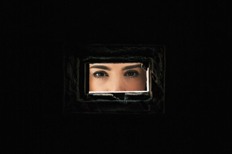 Close-Up Of Woman Seen Through Hole