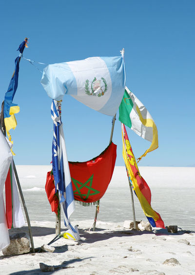 Argentina Flag Bolivia Morocco Flag Salar Uyuni Beauty In Nature Blue Clear Sky Day Flag Multi Colored Nature No People Outdoors Sky Sunlight Wind