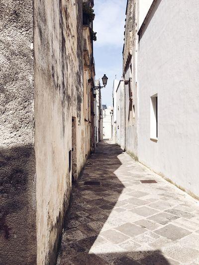 Narrow alley along buildings