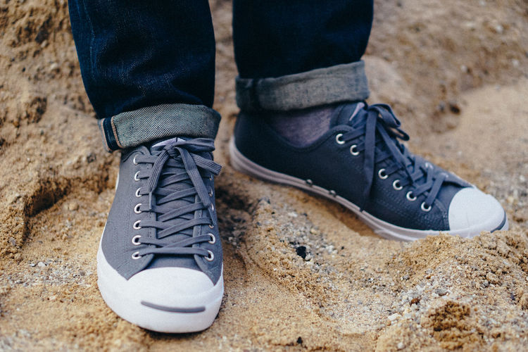 Black Color Body Part Canvas Shoe Casual Clothing Close-up Day Human Body Part Human Foot Human Leg Human Limb Jeans Lace - Fastener Leather Leisure Activity Lifestyles Low Section Men One Person Outdoors Real People Shoe Shoelace Standing