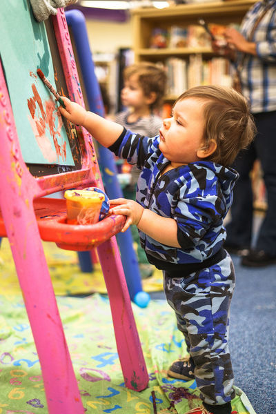 At Shoelane Library Artist Blonde Bookshelf Canvas First Library Messy Art Art And Craft Boy Brush Camouflage Clothing Casual Clothing Childhood Curiosity Cute Focus On Foreground Leisure Activity One Person Painter Painting Real People Toddler  Toddler Boy Toddlerlife