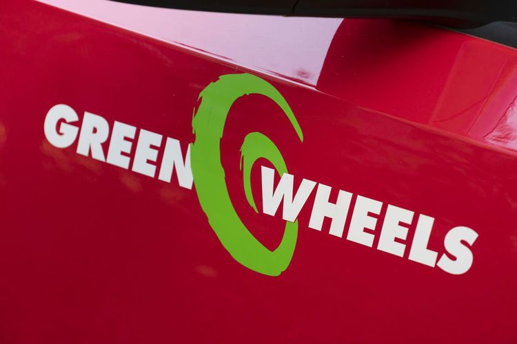Greenwheels symbol. Greenwheels is the largest carsharing corporation in the Netherlands and also operates in Germany Car Car Sharing Carsharing Close-up Communication Green Wheels Greenwheels Motor Vehicle No People Red Sign Text Western Script