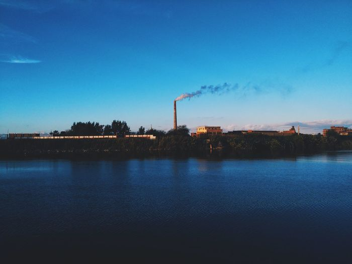 Smoke Stack Industry Water Outdoors Chimney Day Emitting Factory Sky Fumes Smoke - Physical Structure Smoke Air Pollution No People Cooling Tower First Eyeem Photo