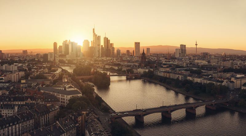 Skyline of Frankfurt at sunset panorama Business Frankfurt Frankfurt Am Main Panorama Skyline Aerial View Architecture Bridge Building Exterior Built Structure Business Finance And Industry City Cityscape Clear Sky Main No People Outdoors River Sky Skyscraper Sunbeams Sunrise Sunset Travel Destinations Urban Skyline